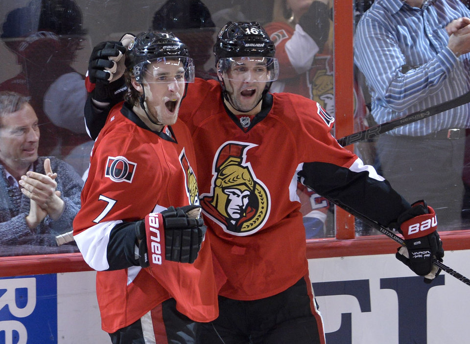 Photo - Ottawa Senators center Kyle Turris, left, celebrates his second-period goal with Clarke MacArthur against the Montreal Canadiens during an NHL hockey game Thursday, Jan. 16, 2014, in Ottawa, Ontario. (AP Photo/The Canadian Press, Adrian Wyld)