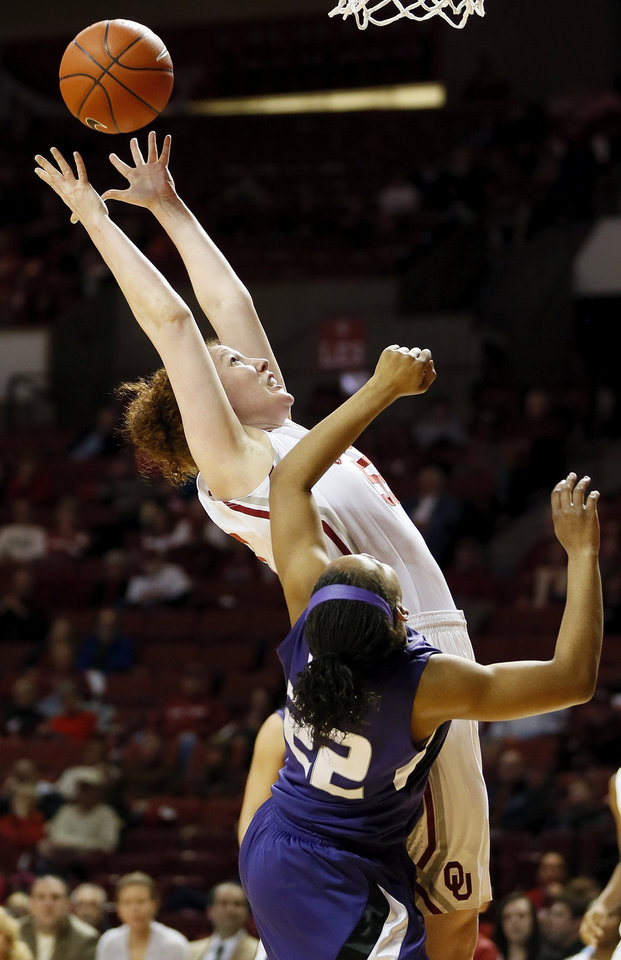 Photo - Oklahoma's Joanna McFarland (53) grabs a rebound against Kansas State's Mariah White (22) during an NCAA women's college basketball game between the University of Oklahoma (OU) and Kansas State at Lloyd Noble Center in Norman, Okla., Wednesday, Feb. 20, 2013. Photo by Nate Billings, The Oklahoman