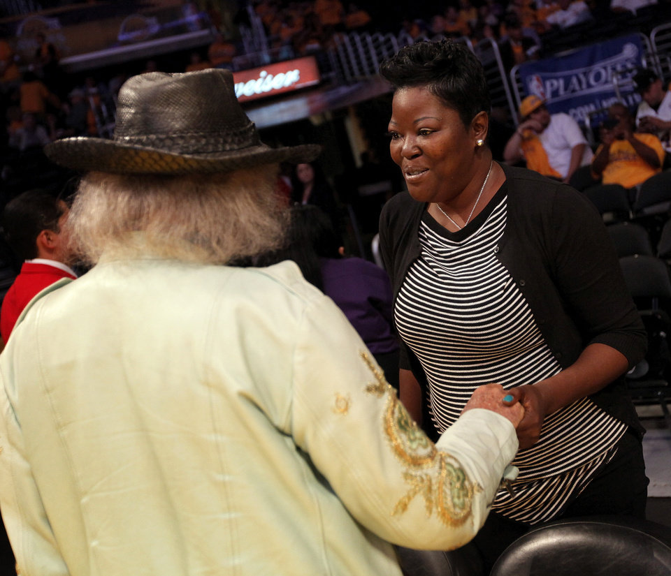 Photo - Wanda Pratt, Kevin Durant's mother, talks with James Goldstein before Game 3 in the second round of the NBA basketball playoffs between the L.A. Lakers and the Oklahoma City Thunder at the Staples Center in Los Angeles, Friday, May 18, 2012. Photo by Nate Billings, The Oklahoman