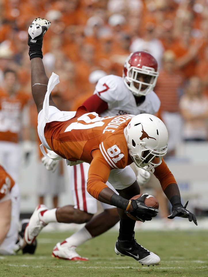 Photo - Texas' Miles Onyegbule (81) is brought down during the Red River Rivalry college football game between the University of Oklahoma Sooners (OU) and the University of Texas Longhorns (UT) at the Cotton Bowl in Dallas, Saturday, Oct. 8, 2011. Oklahoma won 55-17. Photo by Bryan Terry, The Oklahoman