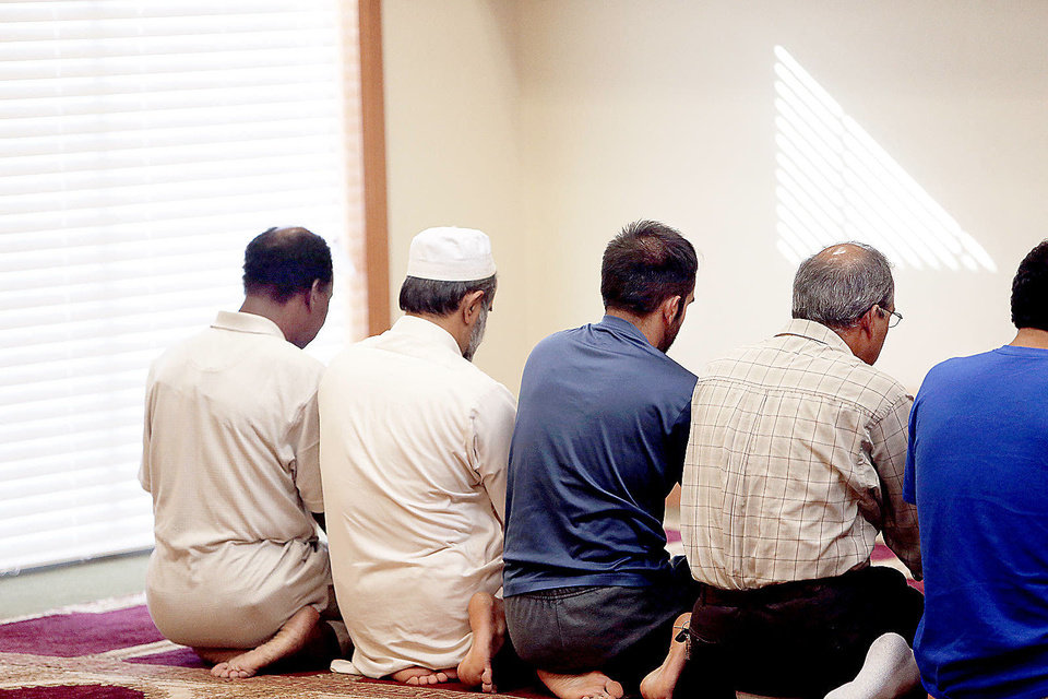 Photo - Men pray at the Masjid-An-Nur mosque in Norman Okla., Tuesday, July 17, 2012. Photo by Sarah Phipps, The Oklahoman. ORG XMIT: OKOKL