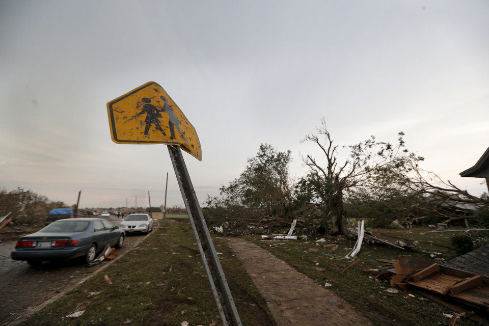 A school sign is surrounded by damage at the Towers Elementary school in Moore following a deadly tornado, Monday, May 20, 2013. Photo by Sarah Phipps, The Oklahoman