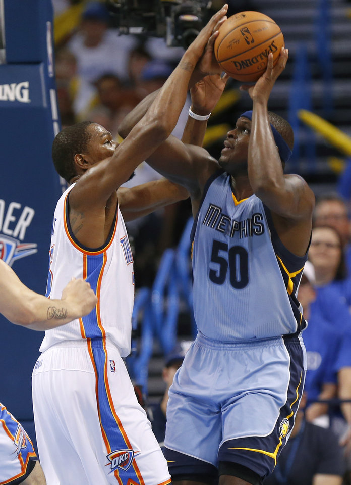 Photo - Oklahoma City's Kevin Durant (35) defends Memphis' Zach Randolph (50) during Game 2 in the first round of the NBA playoffs between the Oklahoma City Thunder and the Memphis Grizzlies at Chesapeake Energy Arena in Oklahoma City, Monday, April 21, 2014. Photo by Nate Billings, The Oklahoman