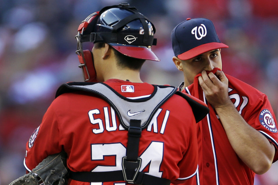 Washington Nationals starting pitcher Gio Gonzalez, right, stands on the mound with catcher Kurt Suzuki after walking St. Louis Cardinals' Carlos Beltran during the fifth inning in Game 1 of baseball's National League division series, Sunday, Oct. 7, 2012, in St. Louis. (AP Photo/Jeff Roberson)