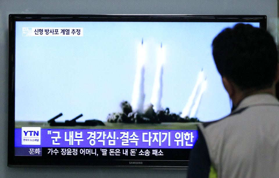 Photo - A man watches a TV news program showing the missile launch conducted by North Korea, at Seoul Railway Station in Seoul, South Korea, Thursday, June 26, 2014. North Korea fired three short-range projectiles Thursday into the waters off its east coast, a South Korean defense official said. The move was most likely a routine test-firing, but the official said it could also be meant to stoke tensions with Seoul. The writing on tje screen reads