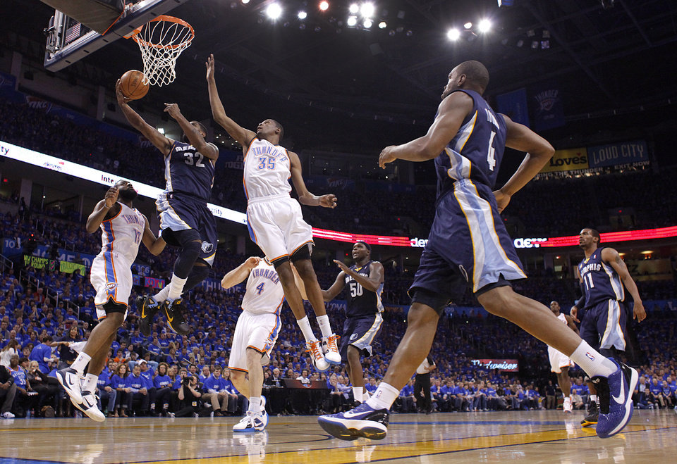 Photo - Oklahoma City's Kevin Durant (35) tires to defend on Memphis' O.J. Mayo (32) during game one of the Western Conference semifinals between the Memphis Grizzlies and the Oklahoma City Thunder in the NBA basketball playoffs at Oklahoma City Arena in Oklahoma City, Sunday, May 1, 2011. Photo by Chris Landsberger, The Oklahoman