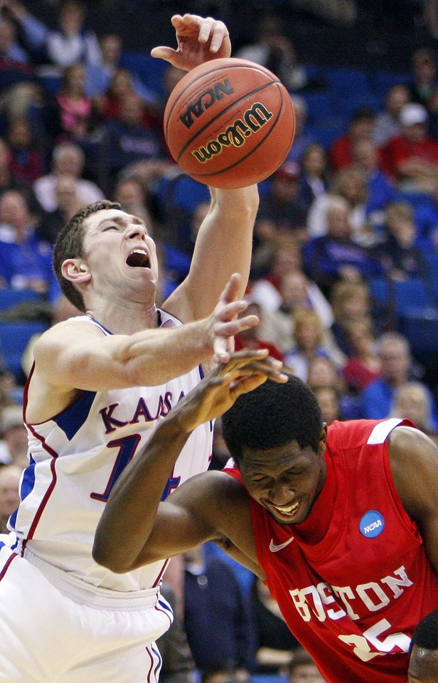 Photo - Tyrel Reed (14) of Kansas and Patrick Hazel (25) of Boston collide in the first half during the NCAA men's basketball tournament second round game between Boston and Kansas at the BOK Center in Tulsa, Okla., Friday, March 18, 2011. Photo by Nate Billings, The Oklahoman