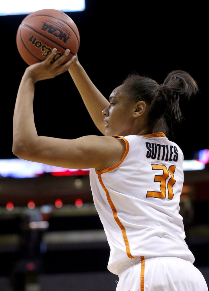 Photo - Oklahoma State's Kendra Suttles (31) shoots a three-point basket during the Women's Big 12 basketball tournament at  Chesapeake Energy Arena  in Oklahoma City, Okla., Saturday, March 8, 2014. Photo by Sarah Phipps, The Oklahoman