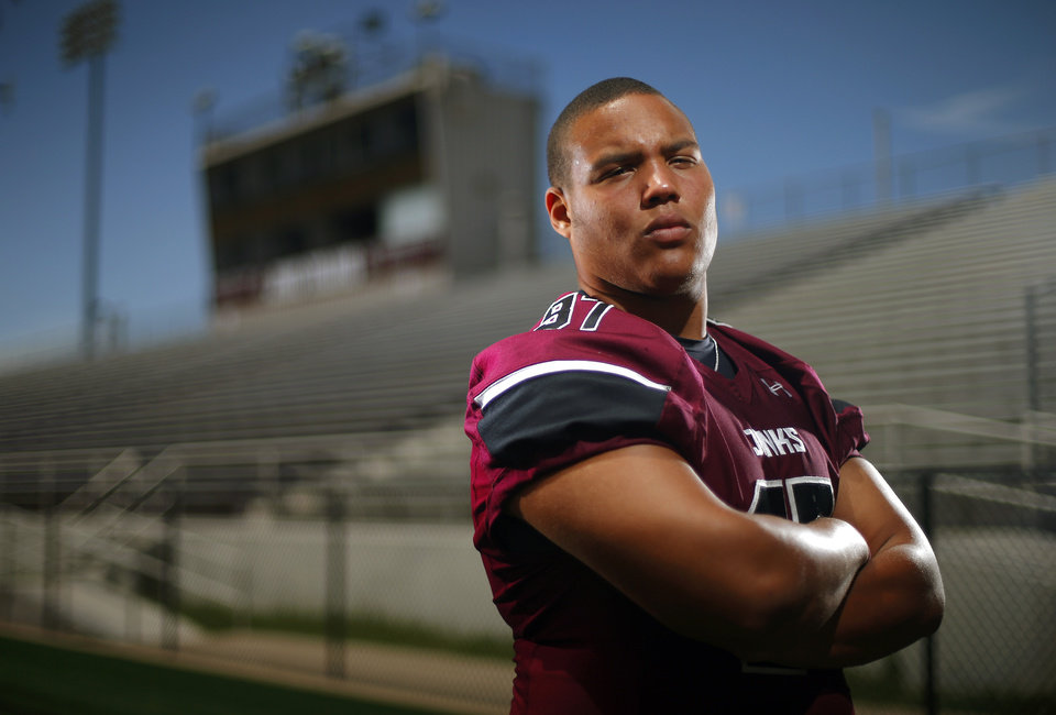 Photo - Marquise Overton of Jenks poses for a portrait at the Jenks high school football field on Tuesday, July 15, 2014. Photo by Bryan Terry, The Oklahoman