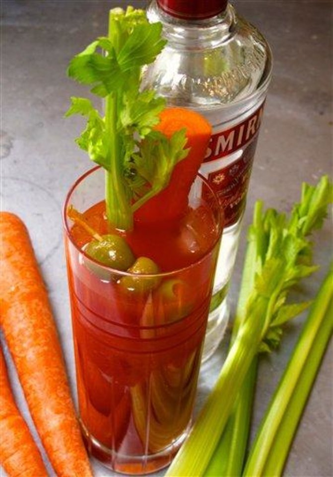 Photo - This March 5, 2013 photo shows a Bloody Mary with garden supplied swizzle sticks in a kitchen in a residential home in Langley, Wash. Botanicals can be used to ferment, distill, mix and decorate alcoholic beverages. Many plants, best if grown organically, like spearmint (mint julep), olives (martini), carrots and celery (Bloody Mary) can be used as garnishes in cocktails. (AP Photo/Dean Fosdick)