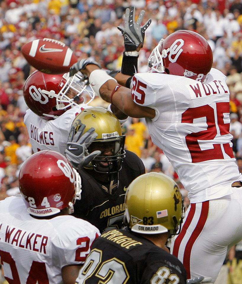 Oklahoma\'s Lendy Holmes (11) and D.J. Wolfe (25) break up a pass in the end zone for Colorado\'s Kendrick Celestine (5) during the first half of the college football game between the University of Oklahoma Sooners (OU) and the University of Colorado Buffaloes (CU) at Folsom Field on Saturday, Sept. 28, 2007, in Boulder, Co. By CHRIS LANDSBERGER, The Oklahoman