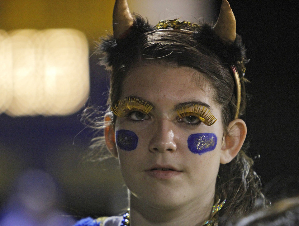 Photo - Dibble's Victoria Baker supports her Demon football team during the high school football playoff game between Dibble High School and Hominy High School at Dibble High School on Friday, Nov. 18, 2011. in Dibble, Okla.  Photo by Chris Landsberger, The Oklahoman