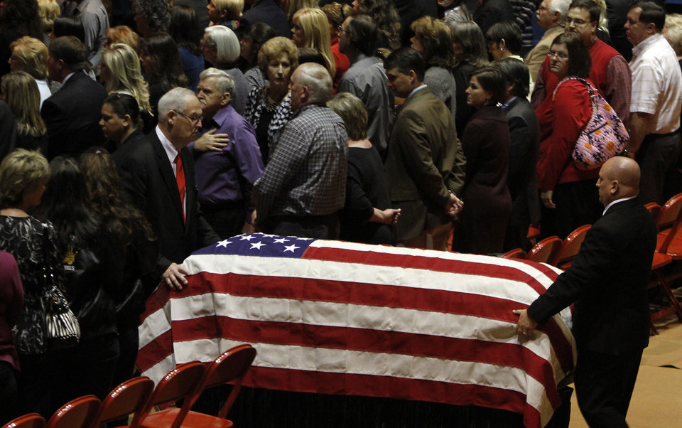 "Friends and family gather to pay respects for Charles ""Chuck"" Poland at the Ozark Civic Center on Sunday, Feb. 3, 2013, in Ozark, Ala. Authorities say Jim Lee Dykes, 65 — a decorated veteran of the Vietnam War known as Jimmy to neighbors — gunned down Poland a school bus driver and then abducted a 5-year-old boy from the bus, taking him to an underground bunker on his rural property. (AP Photo/Butch Dill)"