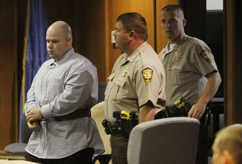 Joshua Steven Durcho is led in chains into a Canadian County courtroom for his sentencing Friday morning. He was sentenced to five life terms without the possibility of parole. Steve Gooch - The Oklahoman