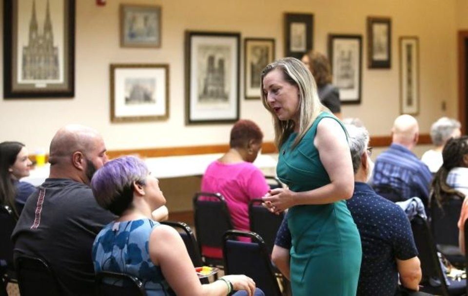 Photo -  U.S. Rep. Kendra Horn speaks with constituents at a town hall in Warr Acres earlier this year. [Sarah Phipps/The Oklahoman]