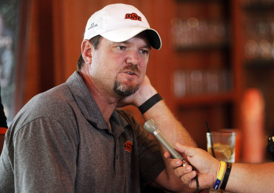 OKLAHOMA STATE UNIVERSITY / OSU: New Oklahoma State defensive line coach Joe Bob Clements speaks to media members at Karsten Creek in Stillwater, Okla., during the annual golf tournament held for media members and football coaches on July 25, 2013. Photo by KT KING, The Oklahoman