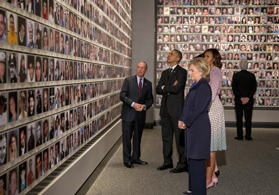 Photo - President Barack Obama and first lady Michelle Obama, along with former Secretary of State Hillary Rodham Clinton and former President Bill Clinton tour the Memorial Hall at the National September 11 Memorial Museum with former New York Mayor Michael Bloomberg, Thursday, May 15, 2014, in New York.  (AP Photo/Carolyn Kaster)