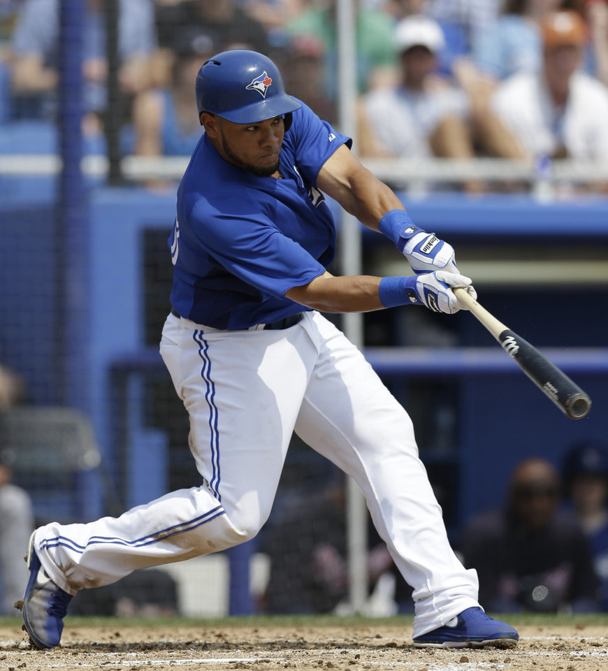 Toronto Blue Jays' Melky Cabrera hits a third-inning solo home run in a spring training baseball game against the Atlanta Braves in Dunedin, Fla., Saturday, March 23, 2013. (AP Photo/Kathy Willens)