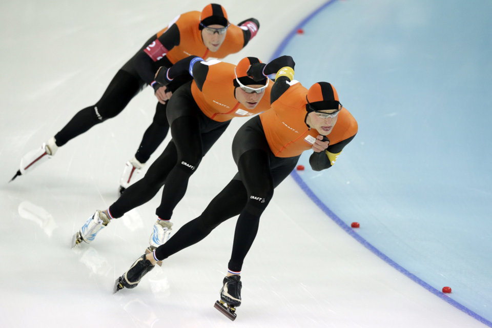Photo - Speedskaters from the Netherlands, front to back, Sven Kramer, Koen Verweij, and Jan Blokhuijsen compete in the men's speedskating team pursuit semifinal race at the Adler Arena Skating Center at the 2014 Winter Olympics, Friday, Feb. 21, 2014, in Sochi, Russia. (AP Photo/Matt Dunham)