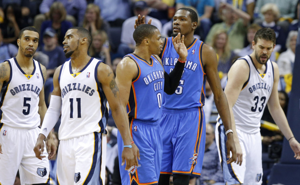Oklahoma City's Kevin Durant (35) celebrates with Russell Westbrook (0) between Memphis' Courtney Lee (5), Mike Conley (11), and Marc Gasol (33) during Game 6  in the first round of the NBA playoffs between the Oklahoma City Thunder and the Memphis Grizzlies at FedExForum in Memphis, Tenn., Thursday, May 1, 2014. Oklahoma City won 104-84. Photo by Bryan Terry, The Oklahoman