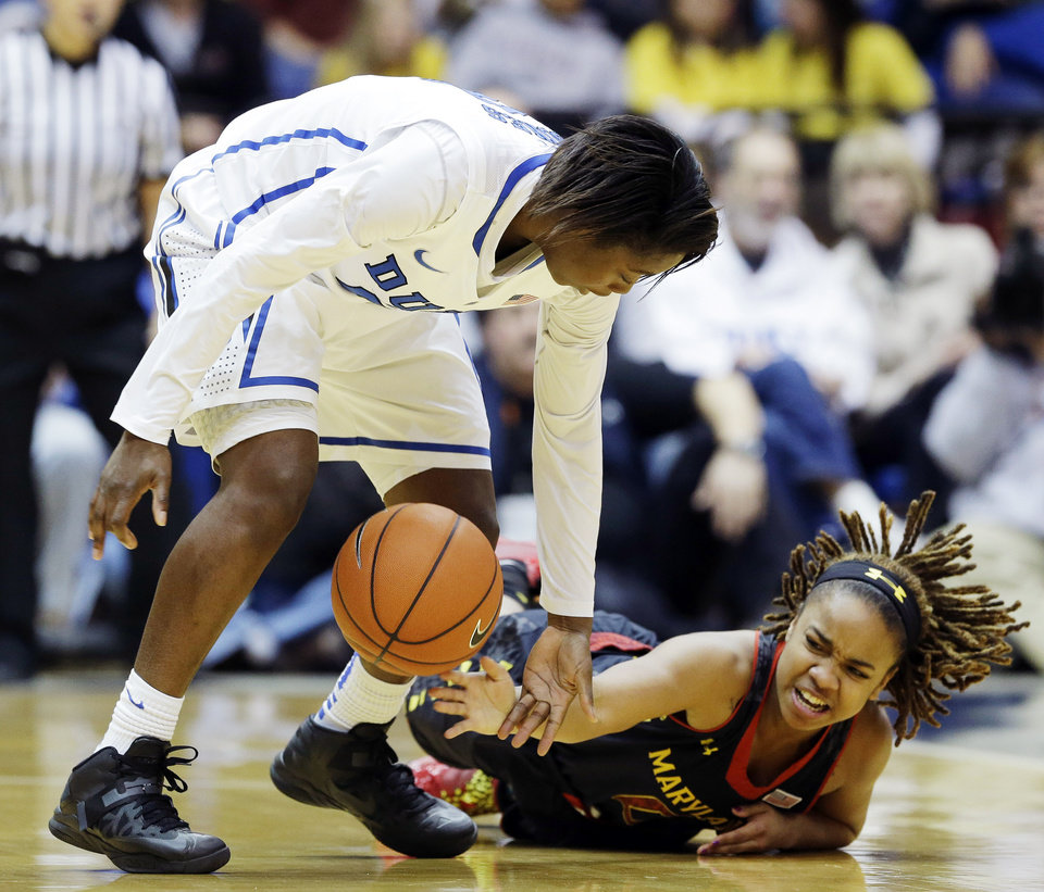 Duke's Alexis Jones, left, and Maryland's Sequoia Austin chase the ball during the first half of an NCAA college basketball game in Durham, N.C., Monday, Feb. 11, 2013. (AP Photo/Gerry Broome)
