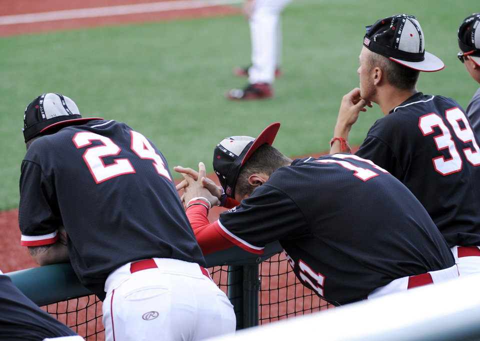 Photo - St. John's players Nick Day (24), Charlie Ameer and Joe Kuzia (39) wear rally caps during the ninth inning of an NCAA college baseball game against Xavier in the Big East tournament Friday, May 23, 2014, in New York. (AP Photo/Bill Kostroun)