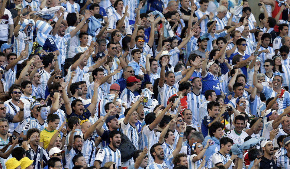 Photo - Argentina fans cheer prior to the World Cup final soccer match between Germany and Argentina at the Maracana Stadium in Rio de Janeiro, Brazil, Sunday, July 13, 2014. (AP Photo/Victor R. Caivano)