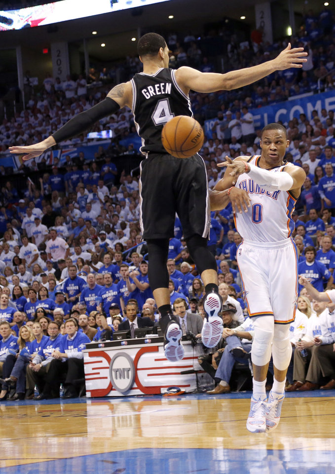 Photo - Oklahoma City's Russell Westbrook (0) passes around San Antonio's Danny Green (4) during Game 4 of the Western Conference Finals in the NBA playoffs between the Oklahoma City Thunder and the San Antonio Spurs at Chesapeake Energy Arena in Oklahoma City, Tuesday, May 27, 2014. Photo by Nate Billings, The Oklahoman