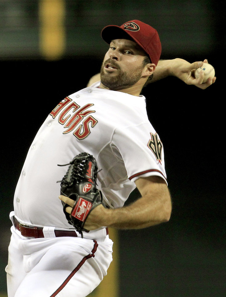 Photo -   Arizona Diamondbacks' Josh Collmenter throws against the Chicago Cubs during the fourth inning in a baseball game on Friday, June 22, 2012, in Phoenix.(AP Photo/Ross D. Franklin)
