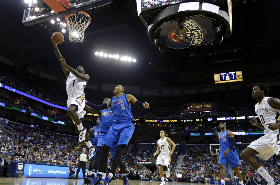 Photo - New Orleans Pelicans point guard Tyreke Evans (1) drives to the basket in front of Dallas Mavericks small forward Shawn Marion (0) in the first half of an NBA basketball game in New Orleans, Wednesday, Dec. 4, 2013. (AP Photo/Gerald Herbert)