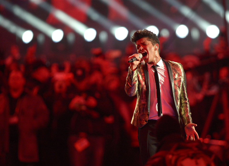 Photo - Bruno Mars performs during the halftime show of the NFL Super Bowl XLVIII football game between the Seattle Seahawks and the Denver Broncos Sunday, Feb. 2, 2014, in East Rutherford, N.J. (AP Photo/Bill Kostroun)