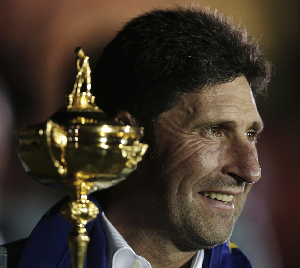 European team captain Jose Maria Olazabal poses with the trophy after winning the Ryder Cup PGA golf tournament Sunday, Sept. 30, 2012, at the Medinah Country Club in Medinah, Ill. (AP Photo/Charlie Riedel)  ORG XMIT: PGA263