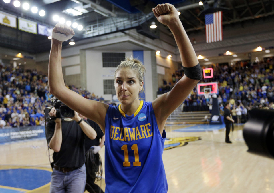 Photo - Delaware guard/forward Elena Delle Donne acknowledges fans as she walks off the court after winning a second-round game against North Carolina in the women's NCAA college basketball tournament in Newark, Del., Tuesday, March 26, 2013. Delle Donne contributed a game-high 33 points to Delaware's win. (AP Photo/Patrick Semansky)  Patrick Semansky