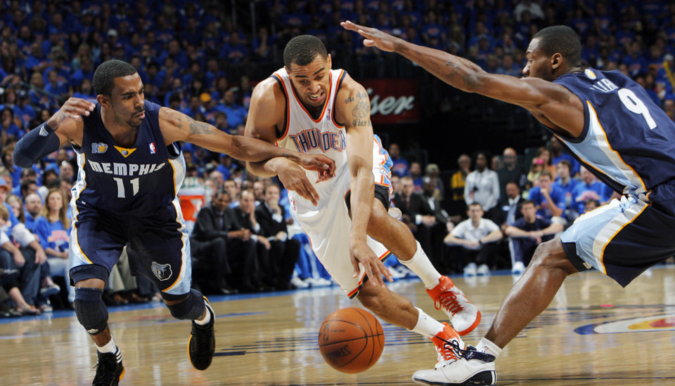 Oklahoma City\'s Thabo Sefolosha (2) dribbles the ball between Mike Conley (11) and Tony Allen (9) of Memphis in the first half during game 7 of the NBA basketball Western Conference semifinals between the Memphis Grizzlies and the Oklahoma City Thunder at the OKC Arena in Oklahoma City, Sunday, May 15, 2011. Photo by Nate Billings, The Oklahoman