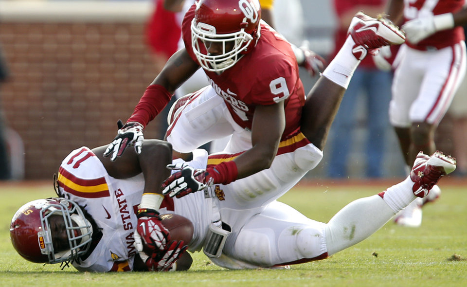 Oklahoma's Gabe Lynn (9) stops Iowa State's E.J. Bibbs (11) during the college football game between the University of Oklahoma Sooners (OU) and the Iowa State University Cyclones (ISU) at Gaylord Family-Oklahoma Memorial Stadium in Norman, Okla. on Saturday, Nov. 16, 2013. Photo by Chris Landsberger, The Oklahoman