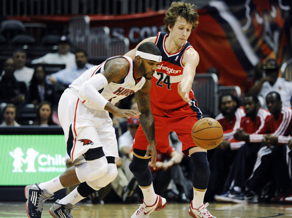 Photo -   Atlanta Hawks' Josh Smith (5) steals the ball from Washington Wizards' Jan Vesely in the first half of an NBA basketball game at Philips Arena in Atlanta, Wednesday, Nov. 21, 2012. (AP Photo/David Tulis)