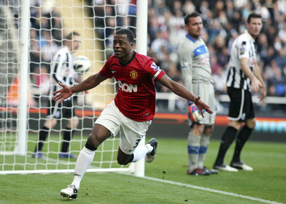 Manchester United's captain Patrice Evra, celebrates after scoring his goal against Newcastle United during their English Premier League soccer match at the Sports Direct Arena, Newcastle, England, Sunday, Oct. 7, 2012. (AP Photo/Scott Heppell)