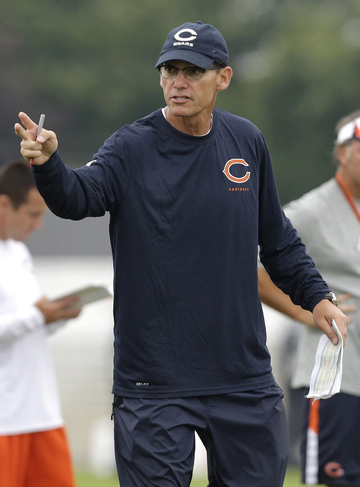 Photo - Chicago Bears head coach Marc Trestman talks to his team during NFL football training camp Wednesday, July 31, 2013, in Bourbonnais, Ill. (AP Photo/Nam Y. Huh)