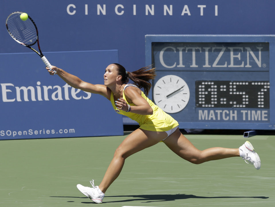 Photo - Jelena Jankovic, from Serbia, returns a serve against Serena Williams during a match at the Western & Southern Open tennis tournament, Friday, Aug. 15, 2014, in Mason, Ohio. Williams won 6-1, 6-3. (AP Photo/Al Behrman)
