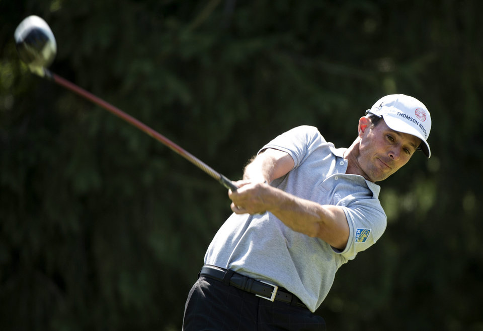 Photo - Mike Weir from Brights Grove, Ontario, hits off the eighth tee during first round play at the Canadian Open golf championship on Thursday, July 24, 2014, in Montreal. (AP Photo/The Canadian Press, Paul Chiasson)