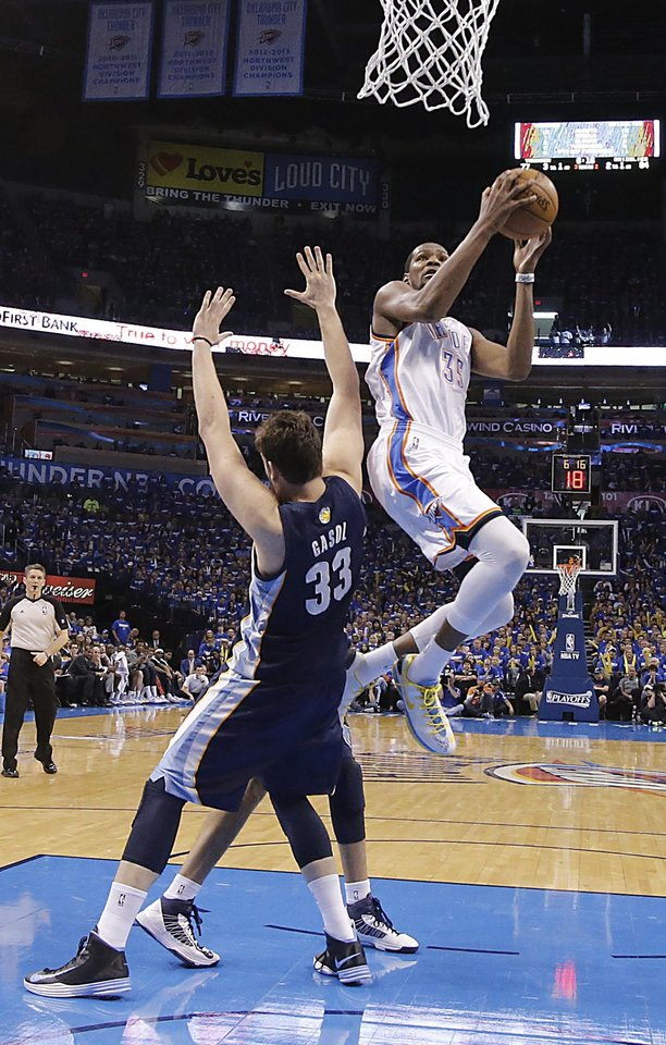 Oklahoma City\'s Kevin Durant (35) puts up a shot past Memphis\' Marc Gasol (33) during the second round NBA playoff basketball game between the Oklahoma City Thunder and the Memphis Grizzlies at Chesapeake Energy Arena in Oklahoma City, Sunday, May 5, 2013. Photo by Chris Landsberger, The Oklahoman