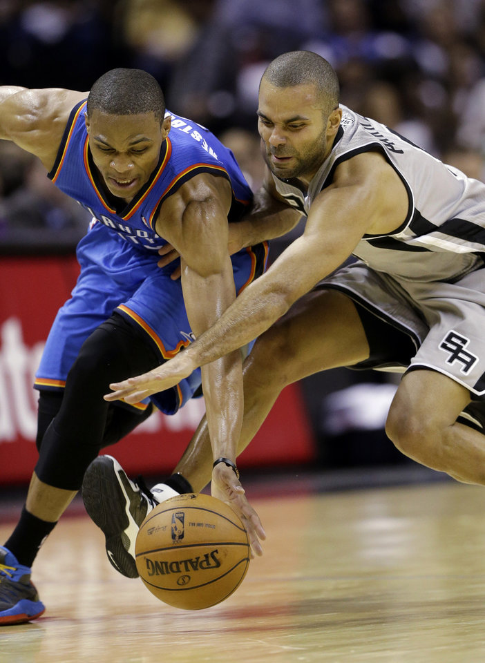 Oklahoma Thunder's Russell Westbrook, left, and San Antonio Spurs' Tony Parker, right, of France, chase a loose ball during the third quarter of an NBA basketball game, Thursday, Nov. 1, 2012, in San Antonio. (AP Photo/Eric Gay) ORG XMIT: TXEG112