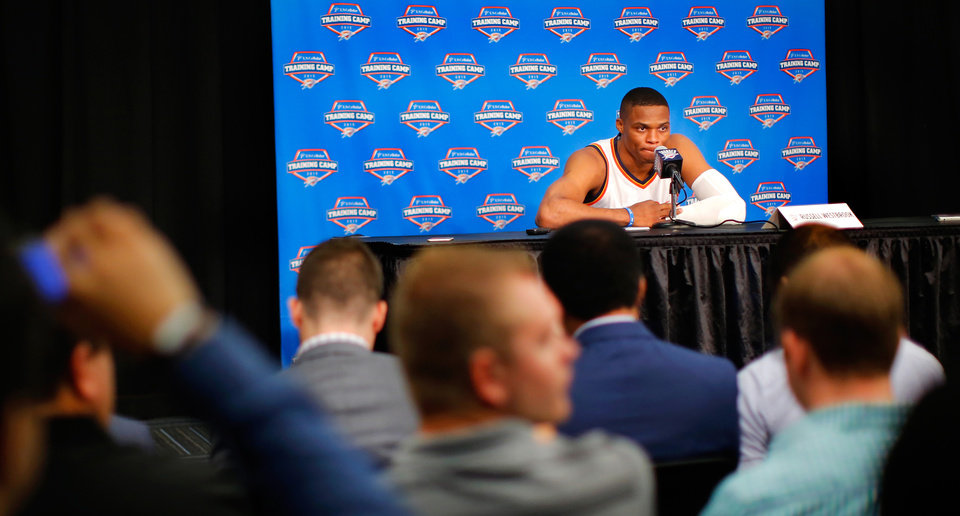Photo - Russell Westbrook appears in front of a room filled with reporters during media day interviews and photo sessions for the 2015-2016 Oklahoma City Thunder basketball team inside Chesapeake Arena on Monday, Sep. 28, 2015. Photo by Jim Beckel, The Oklahoman.