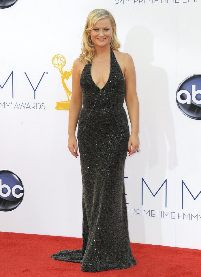 Photo -   FILE - In this Sept. 23, 2012 file photo, actress Amy Poehler arrives at the 64th Primetime Emmy Awards at the Nokia Theatre, in Los Angeles. The Hollywood Foreign Press Association, dick clark productions and NBC announced Monday, Oct. 15, 2012, that Tina Fey and Amy Poehler, have signed on to host the 70th annual ceremony after British comedian Ricky Gervais' three-year reign as the ceremony's acerbic master of ceremonies. The Golden Globes are set to air on NBC on Jan. 13, 2013. (Photo by Jordan Strauss/Invision/AP, File)