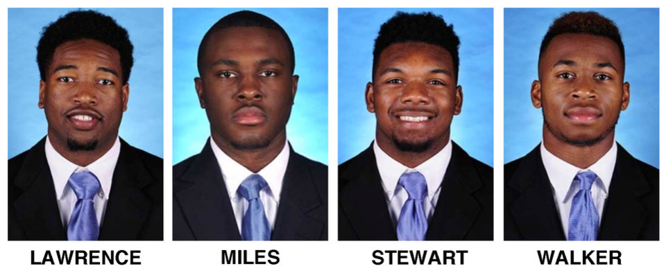 Photo - These undated photos provided by the University of North Carolina shows football players, from left, Des Lawrence and Brian Walker, Donnie Miles and M.J. Stewart. North Carolina coach Larry Fedora says the team has suspended the four players for this weekend's season opener, a day after a report of an alleged hazing altercation left a walk-on receiver with a possible concussion. (AP Photo/University of North Carolina)