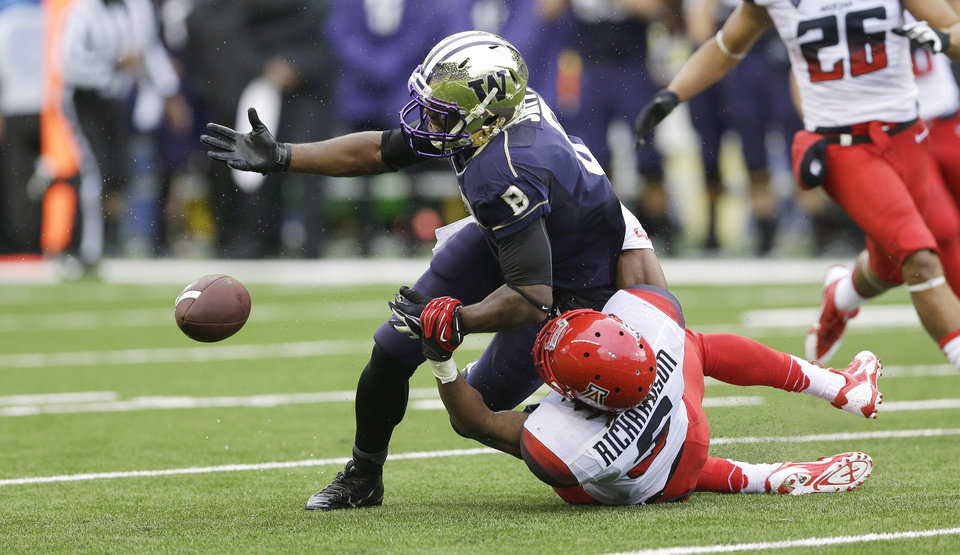 Photo - Arizona's Shaquille Richardson breaks up a pass intended for Washington's Kevin Smith (8) in the first half of an NCAA college football game, Saturday, Sept. 28, 2013, in Seattle. (AP Photo/Ted S. Warren)