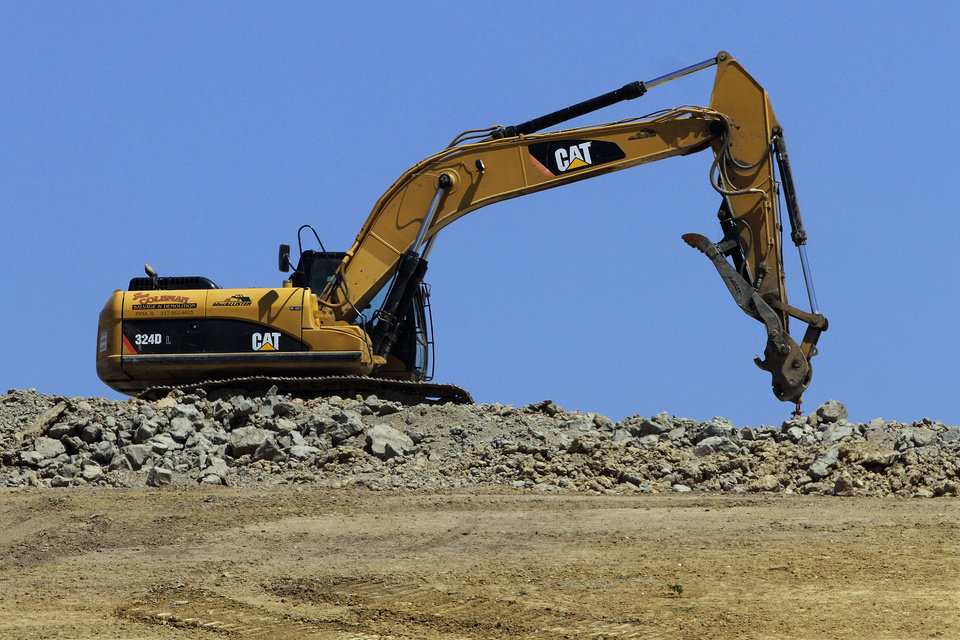 """Photo -   FILE - In this Wednesday, June 20, 2012, file photo a caterpillar machine is used at the Clinton Landfill in Clinton, Ill. Caterpillar cut its profit and revenue guidance on Monday, Oct. 22, 2012, saying the world's economic conditions """"are weaker than we had previously expected."""" Caterpillar Inc. is the world's largest construction and mining equipment maker, so its results are watched closely as a sign of where the broader economy is headed. (AP Photo/Seth Perlman, File)"""