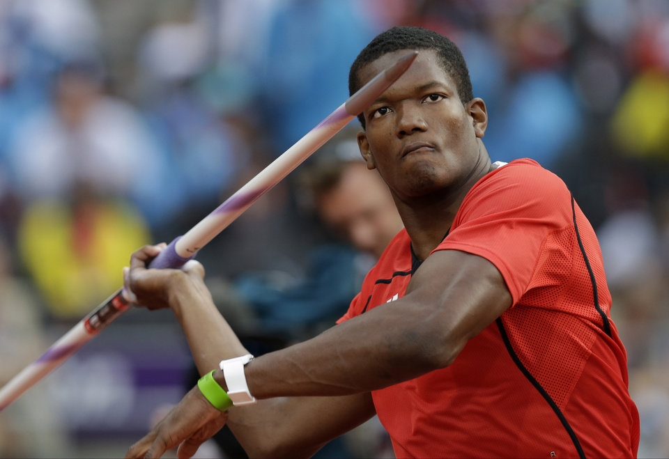 Photo -   Trinidad's Keshorn Walcott takes a throw in the men's javelin throw final during the athletics in the Olympic Stadium at the 2012 Summer Olympics, London, Saturday, Aug. 11, 2012. Walcott went on to win the gold medal. (AP Photo/David J. Phillip )