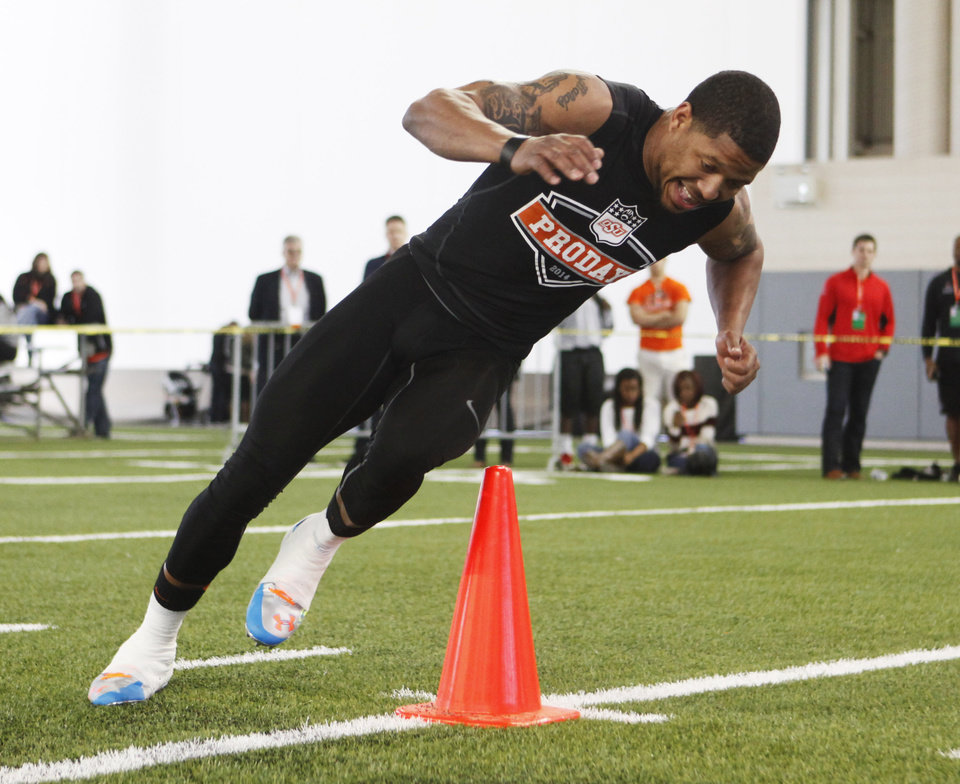 Photo - Receiver Josh Stewart runs a drill during a workout at Oklahoma State's pro day held at Boone Pickens Stadium in Stillwater on Thursday, March 13, 2014. Photo by KT King, The Oklahoman