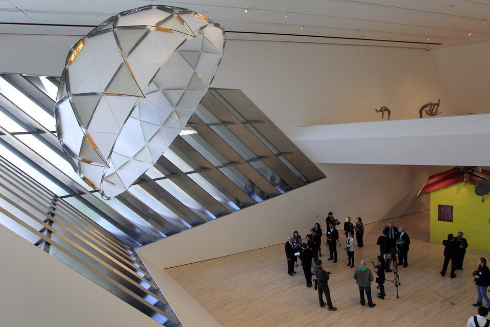 Photo -   In this Nov. 9, 2012 photo members of the media tour the Eli and Edythe Broad Art Museum on Michigan State University's campus in East Lansing, Mich. The canopy sculpture seen at upper left is